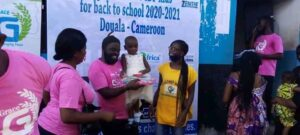 Pa Tom handing over gifts to kids in Douala