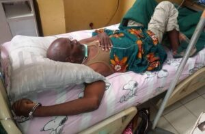 Anglophone detainee, Thomas Nganyu, chained to his sick bed at the Yaounde Central Hospital