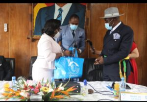 Camtel's GM handing over a Smart pack to the City Mayor