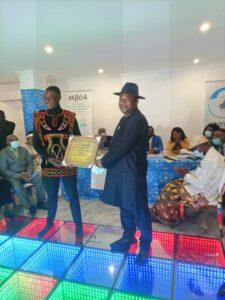 Doh Bertrand receiving his Award in Buea