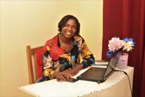 President of Royalty World, Ngum Doris inside her office