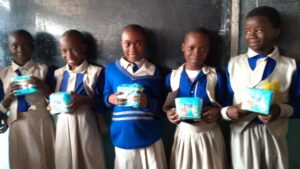 Students, excited after receiving their first menstrual pads
