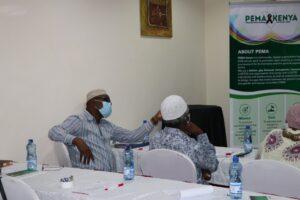 Athumani Abdullah Mohammed (left), a Musli faith leader who has become an ally to Mombasa's LGBTQ community, at a PEMA Kenya discussion in 2018. Credit: PEMA Kenya