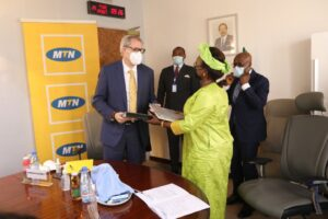 MTN's Managing Director, Stephen BLEWETT (L), and Camtel's GM, Judith Yah Sunday (R), exchanging the signed MoU documents